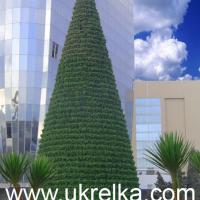 Large picture giant artificial Christmas tree